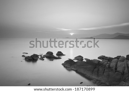 Long exposure dramatic tropical sea and sky sunset in black and white tone - stock photo