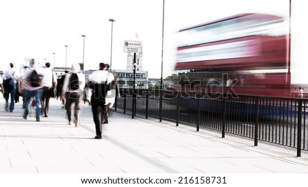 Long exposure, high key abstract captures of anonymous London City workers on their way to the office.  Intentional creative motion blur to indicate movement. - stock photo