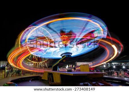 Long exposure light at fun park - stock photo