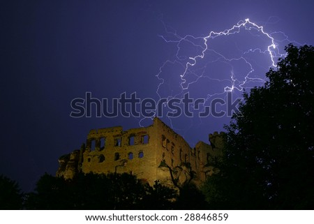 Long exposure lightning display over ruin of castle - stock photo