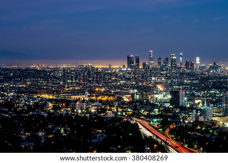Long exposure night view of Los Angeles downtown and surrounding metropolitan area at dusk