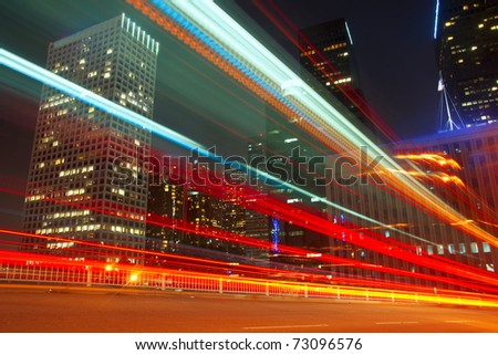 Long exposure of a bus going through downtown Los Angeles, California. - stock photo