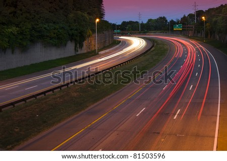 Long exposure of a busy highway at dusk - stock photo