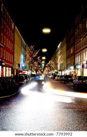 Long exposure of a city street in Munich, Germany at christmas time - stock photo