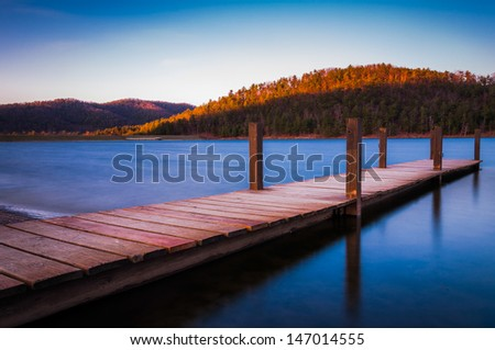 Long exposure of a small dock on Lake Arrowhead, near Shenandoah National Park in Luray, Virginia - stock photo