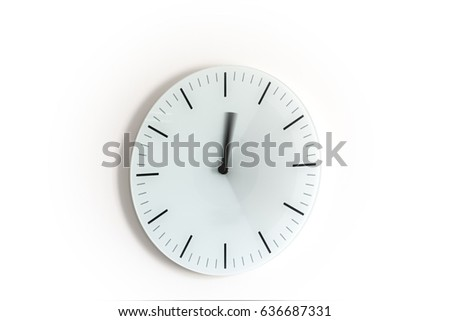 Long exposure of a wall hung clock on a white background