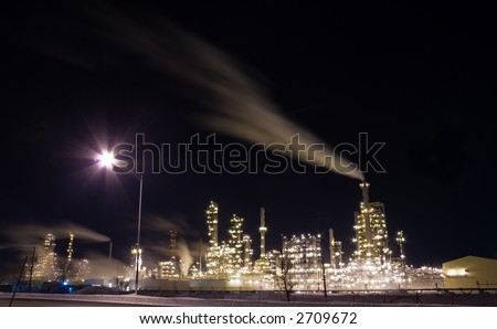Long exposure of an oil refinery at night - stock photo