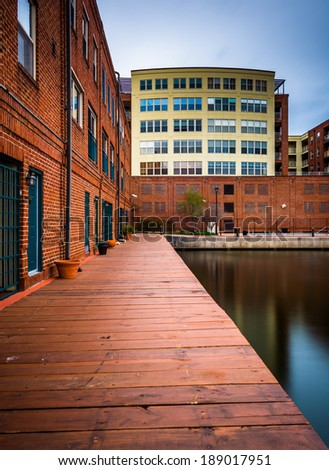 Long exposure of buildings along the waterfront in Fells Point, Baltimore, Maryland. - stock photo