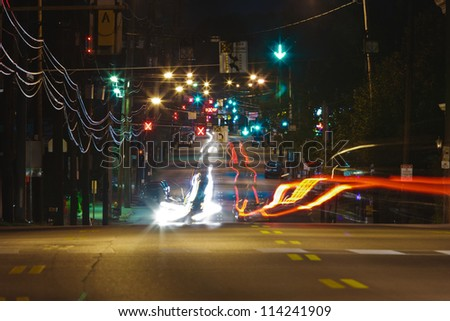 Long Exposure of car headlights and taillights on a city street at night. - stock photo