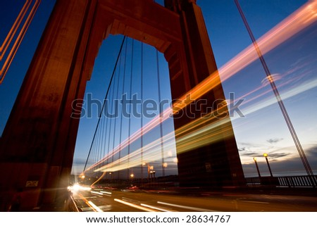 Long exposure of cars passing through one of the towers of the Golden Gate Bridge. Shot in San Francisco. - stock photo