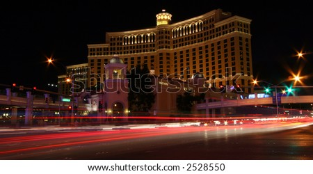 Long Exposure of Casino at Night in Las Vegas with Traffic - stock photo