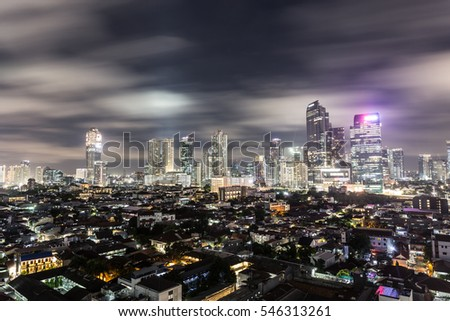 Long exposure of clouds motion over the business district skyline in Jakarta, Indonesia capital city.