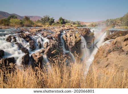 Long exposure of Epupa waterfalls in summer time, the border of Angola and Namibia - stock photo