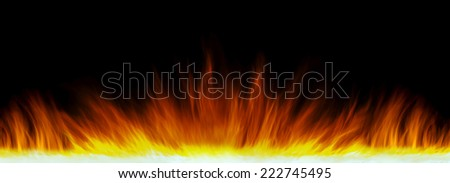 Long exposure of  flames, in a straight line, isolated  on black background