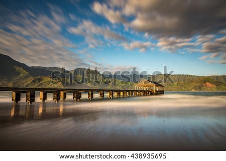long exposure of Hanalei pier at sunrise on the beautiful Island of Kauai, Hawaii - stock photo