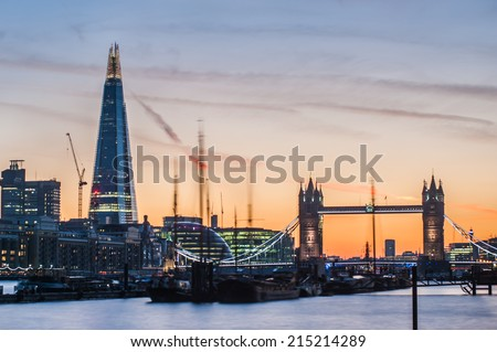 Long exposure of London skyline at sunset with The Shard and Tower Bridge.