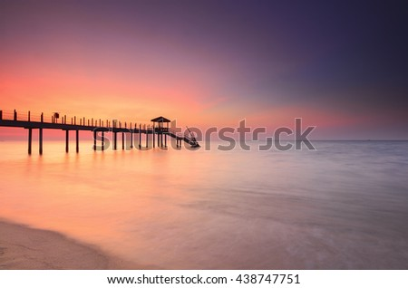 Long exposure of long fisherman jetty during sunset