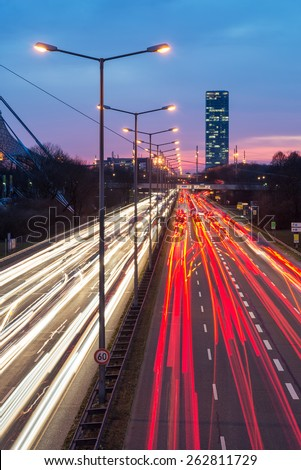 Long exposure of Mittlerer Ring, a multi-lane road with office buildings in the background, Munich, Bavaria, German