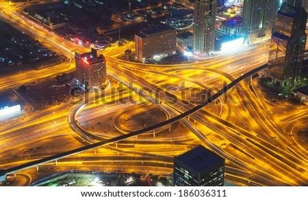 Long exposure of motorway at night city. Crossing of two motorways - stock photo