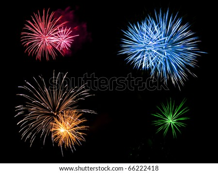 Long Exposure of Multicolored Fireworks Against a Black Sky - stock photo