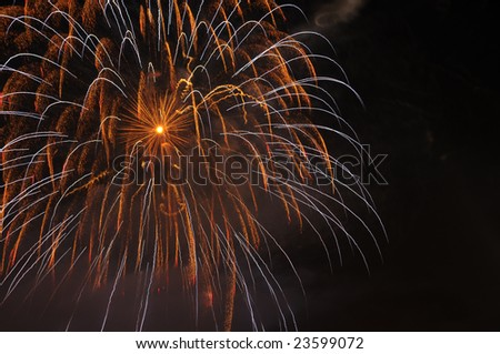 long exposure of multiple fireworks against a black sky