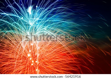 long exposure of multiple fireworks against a black sky - stock photo