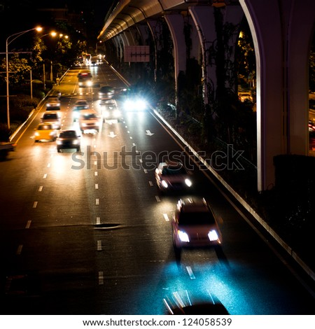 Long exposure of night traffic. motion blur - stock photo