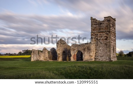 Long exposure of old ruined church at a neolithic henge in Dorset