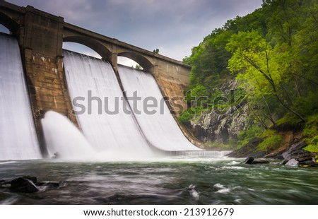 Long exposure of Prettyboy Dam and the Gunpowder River in Baltimore County, Maryland. - stock photo