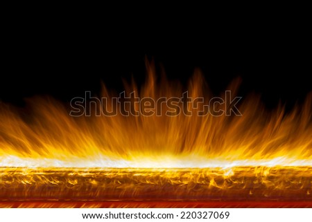 Long exposure of real flames, in a straight line, isolated  on black background