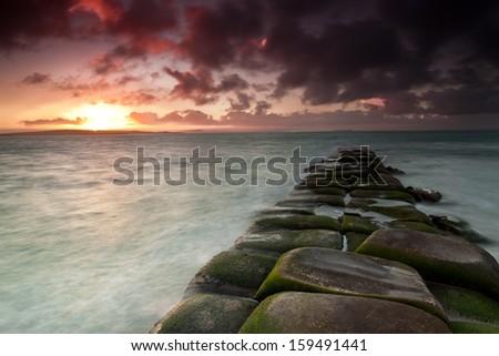 long exposure of rocks and sea   - stock photo