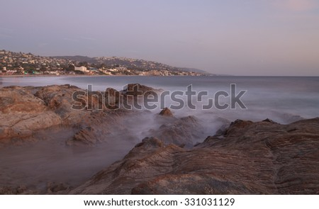 Long exposure of rocks in waves, giving a mist like effect over ocean in Laguna Beach, California