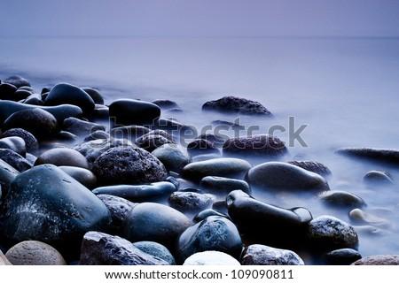 long exposure of sea and rocks - stock photo