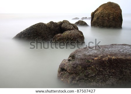 long exposure of sea and rocks. - stock photo
