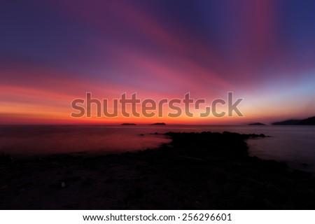 Long exposure of sunset sky at the beach  - stock photo