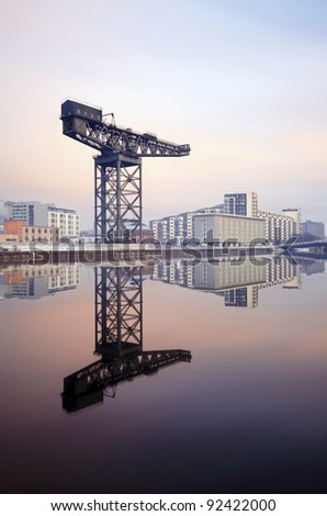 Long exposure of the Finnieston crane in Glasgow, reflecting on a perfectly calm, and crystal clear River Clyde. - stock photo