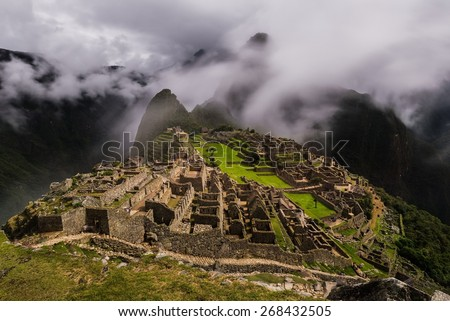 Long-exposure of the foggy ruins of machu picchu - stock photo