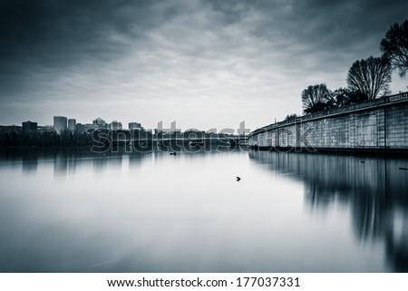 Long exposure of the Potomac River in Washington, DC. - stock photo