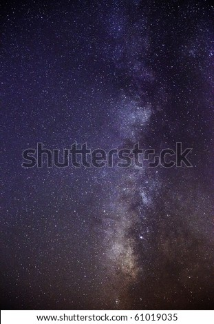 Long exposure of the southern skies clearly showing the Milky Way and the dark nebula or cloud that eclipses most of the light emanating from the centre of our galaxy - stock photo