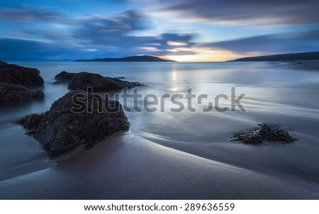 Long exposure of the Sunset over Sands Bay at Gairloch in the North West Highlands of Scotland - stock photo