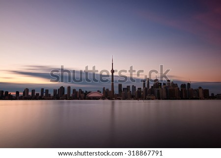 Long exposure of Toronto skyline with Lake Ontario in the foreground, as seen from Center Island.