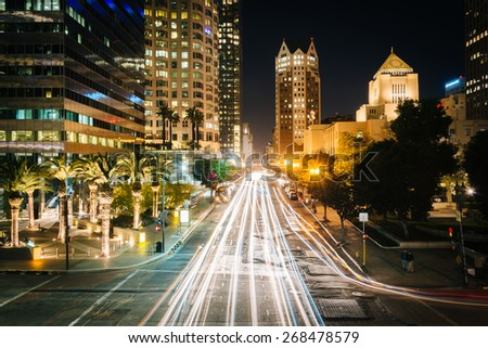 Long exposure of traffic and buildings along 5th Street at night, in downtown Los Angeles, California. - stock photo