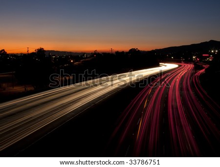 Long Exposure of Traffic at Sunset - stock photo