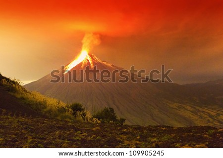 Long exposure of Tungurahua volcano exploding in the night of 29.11.2011,Ecuador .( Large amount of noise visible at full size) - stock photo