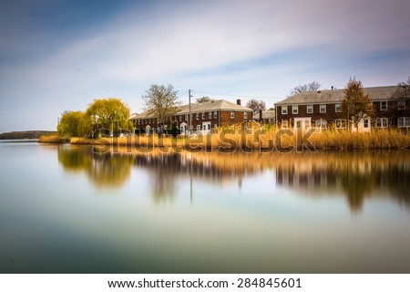 Long exposure of waterfront homes from Turner's Station Park, in Dundalk, Maryland. - stock photo