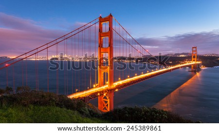 Long exposure panorama of Golden Gate Bridge at sunset. - stock photo