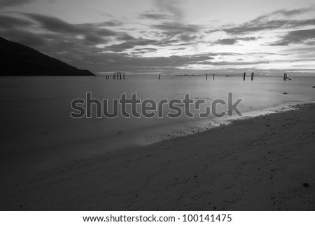 Long exposure photo of beach in the evening, black and white - stock photo
