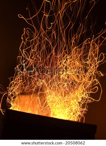 Long exposure photo of fire sparkles - stock photo