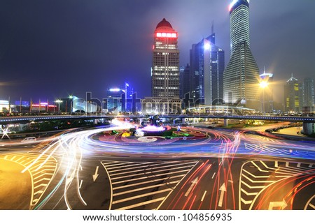 Long exposure photo to dazzling rainbow overpass highway night scene in Shanghai - stock photo