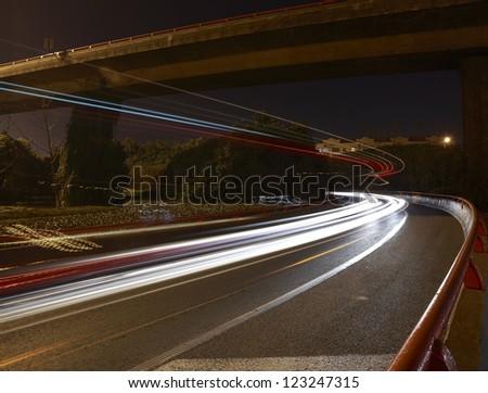 Long exposure photographs of urban night dusk highway traffic - stock photo